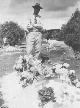 James Elbert Self standing by wife's grave